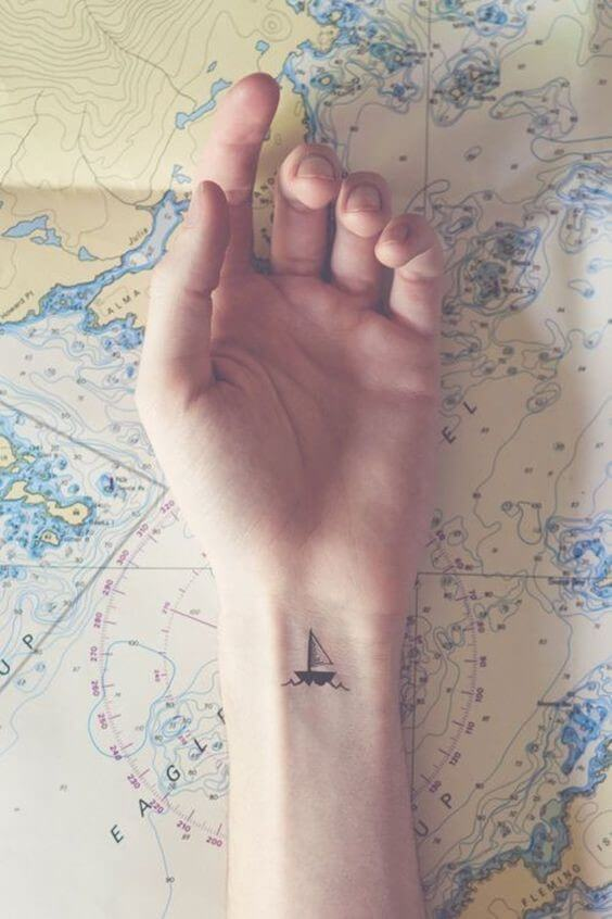 custom small boat temporary tattoo with waves on wrist