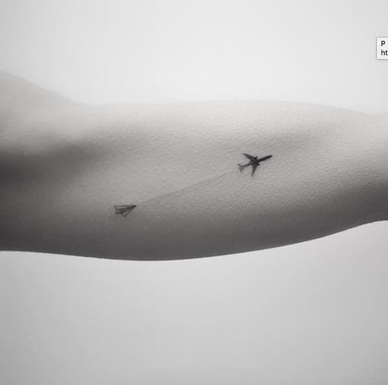 going from paper plane to airplane temporary tattoo on arm