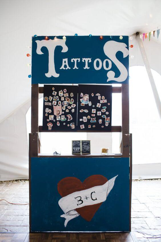 blue colored simple wedding tattoo station with custom wedding tattoos on display