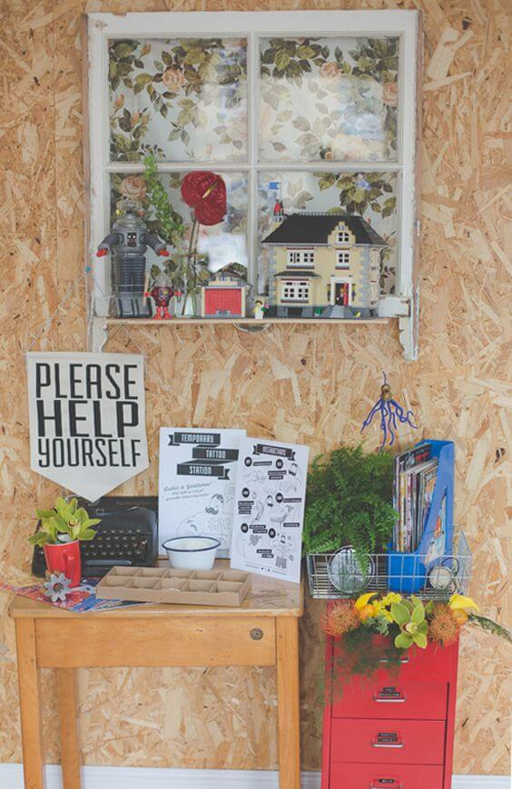 home-style custom fake tattoo booth with items found in everyday homes for decor