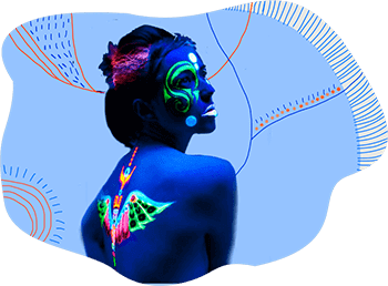 Glow in dark temporary tattoos on the face and bare back of a woman standing in UV light