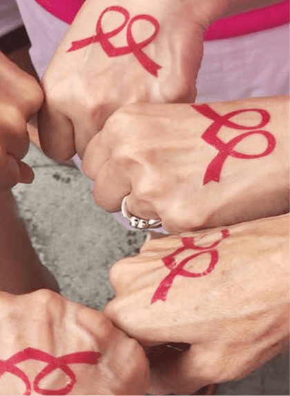 Participants showing off their pink ribbon tattoos for Pink Ribbon walk