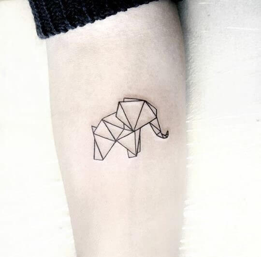 geometric elephant tattoo on arm