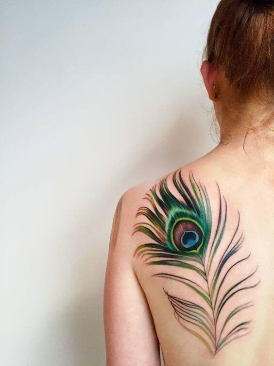 colorful peacock feather tattoo on back