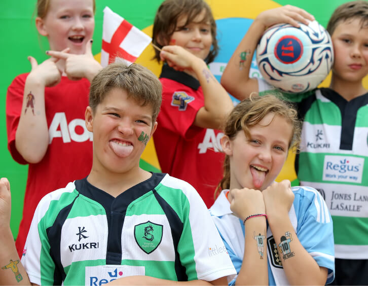 kids showing off their world cup temporary tattoos for brazil world cup