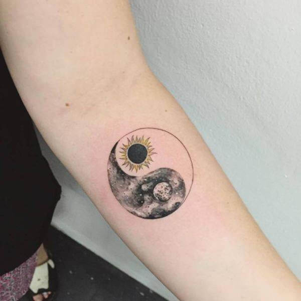 bright sun tattoo and dark moon tattoo encircled on arm