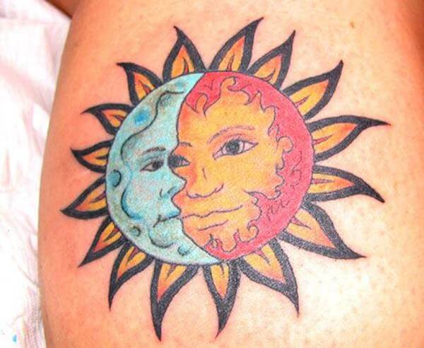 colorful cresent moon tattoo and half sun tattoo combined together on arm