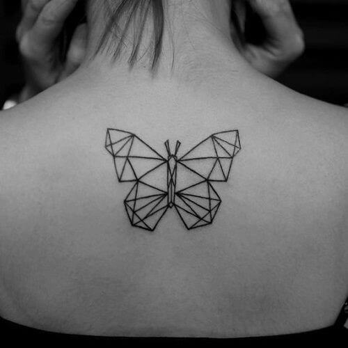 geometric butterfly temporary tattoo on woman's shoulder
