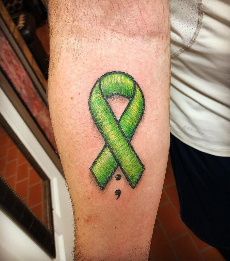 green ribbon embroidery tattoo to raise awareness about non-hodgkin lymphoma