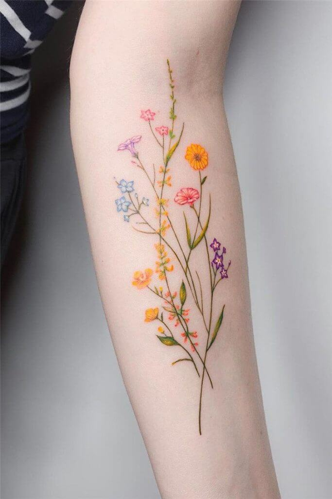 delicate flowers embroidery tattoo on forearm