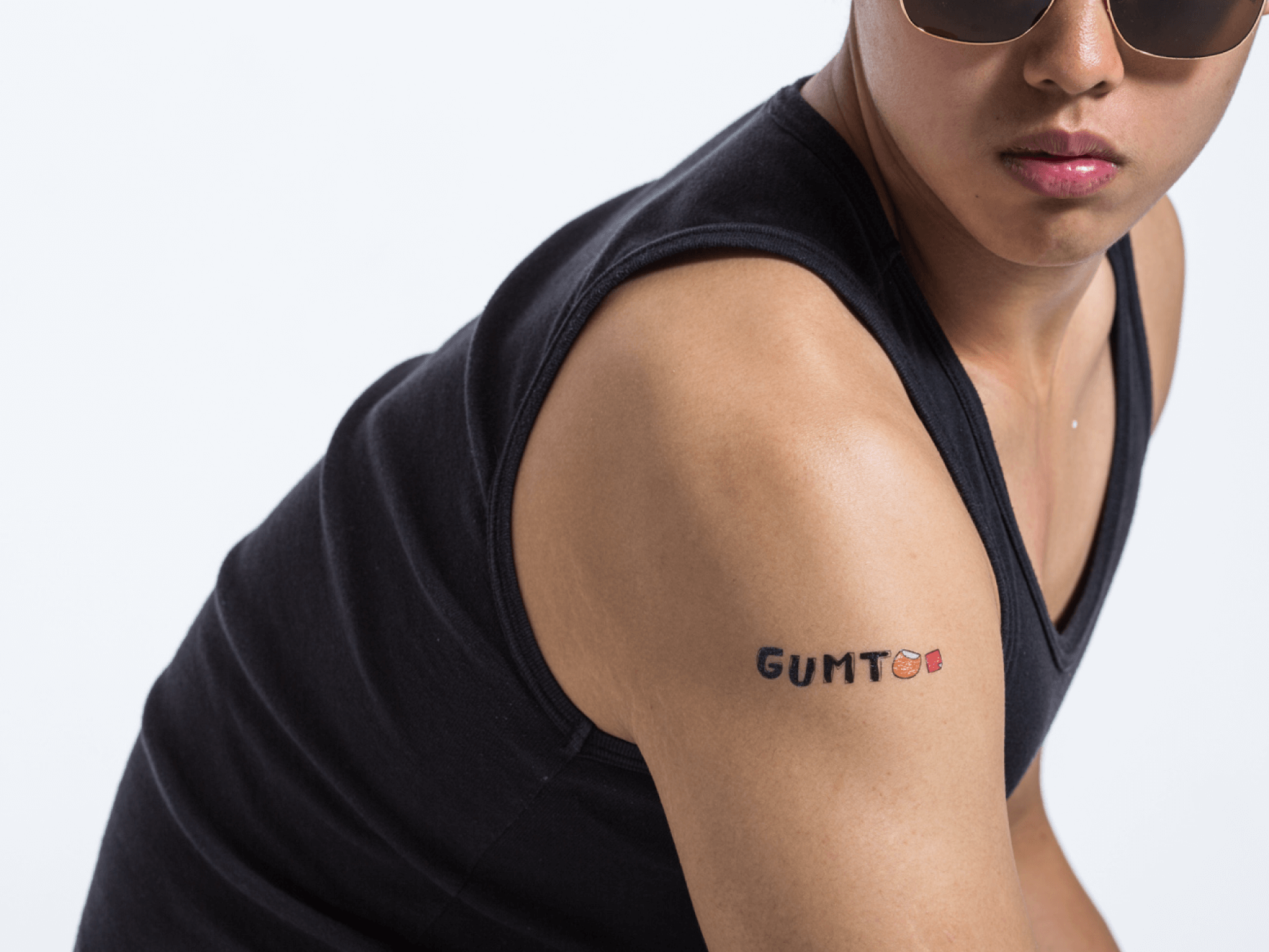guy wearing gumtoo logo tattoo